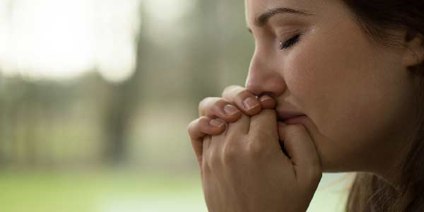 Young woman crying suffering from anxiety