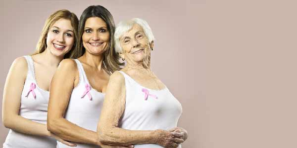 3 woman wearing the pink ribbon for breast cancer day