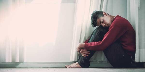 Man on the floor suffering anxiety
