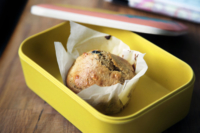 a healthy muffin in a kid's lunchbox